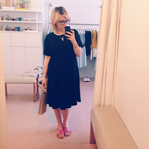 Natasha wearing the Sihu Dress in Black, and Crossover Sandals in Pink by Obus Clothing.